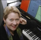 Dr. Alice Cash at the piano